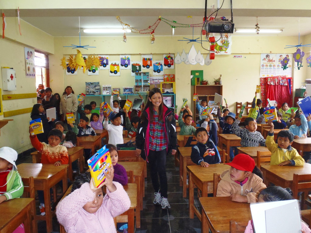 Alexis distributing gifts to Peruvian children.